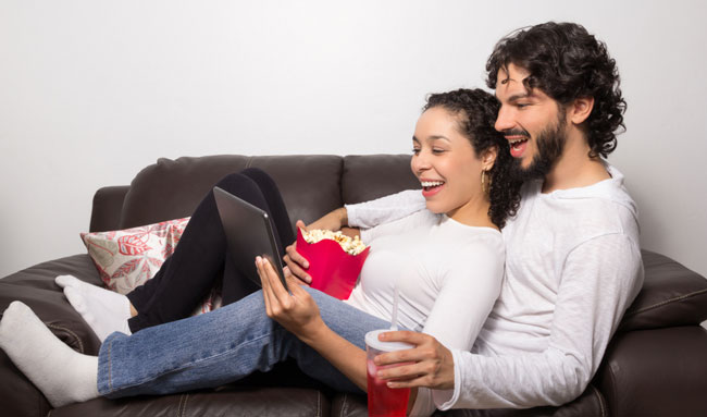 Couple watches video on tablet