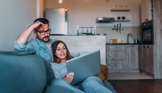 Couple watching a tv on laptop